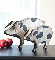 Folk-art-metal-pigs to perch on a table top.