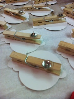 I Love My Classroom: Dicuts glued onto clothespins, glued onto thumb tacks - easy way to dress up and clip student work.