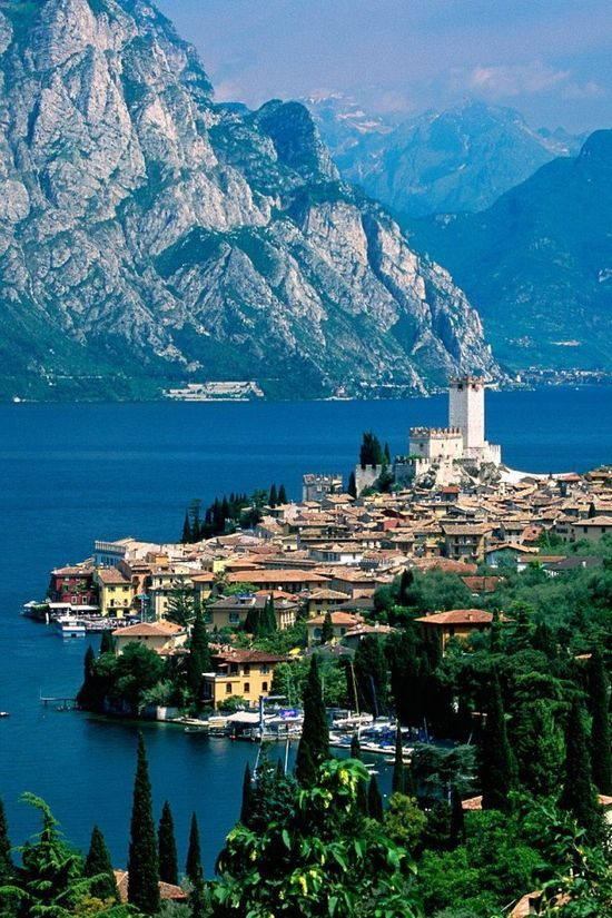 Malcesine by Lake Garda, Italy. I have driven there from the UK many times. Definitely a must go to place, and it's one of my favourite destinations
