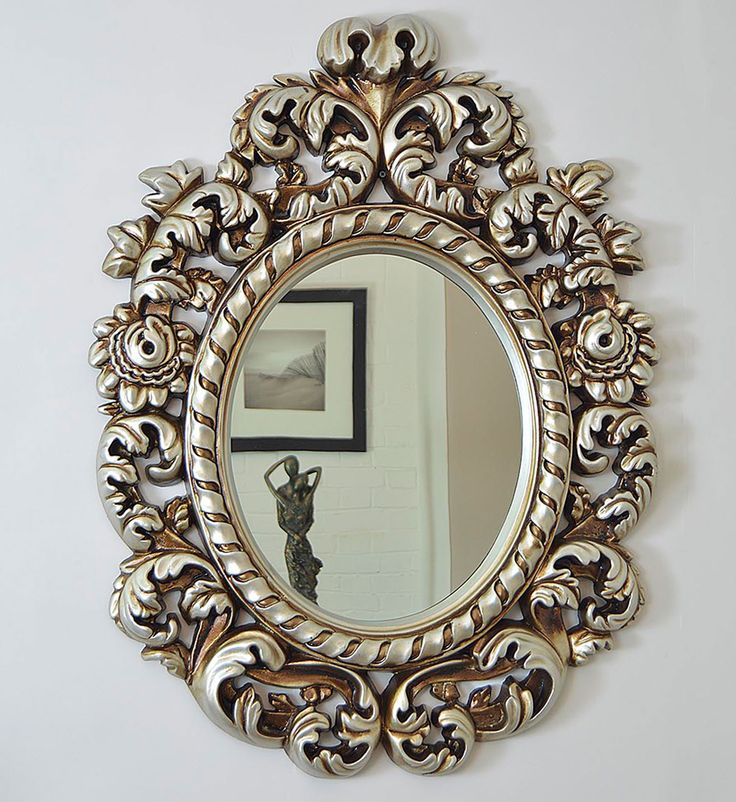 An impressive baroque style very decorative ornate oval wall mirror. Designed to hang in the portrait orientation and finished here in an antique silver painted finish. This item is also available in antique gold, matt black and matt white finish. Overall measurements for this mirror are 3ft3 x 2 ft 5 (99cm x 75cm). This mirror is manufactured from a durable polyurethane mould, giving a sturdy but lightweight finish which in turn allows for easy wall hanging. internal glass measures 38cm x…
