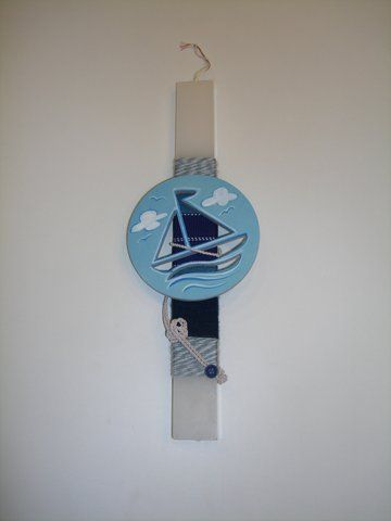 Handmade Easter candle decorated with hand painted wooden Sailing boat figure.  www.artimiva.gr