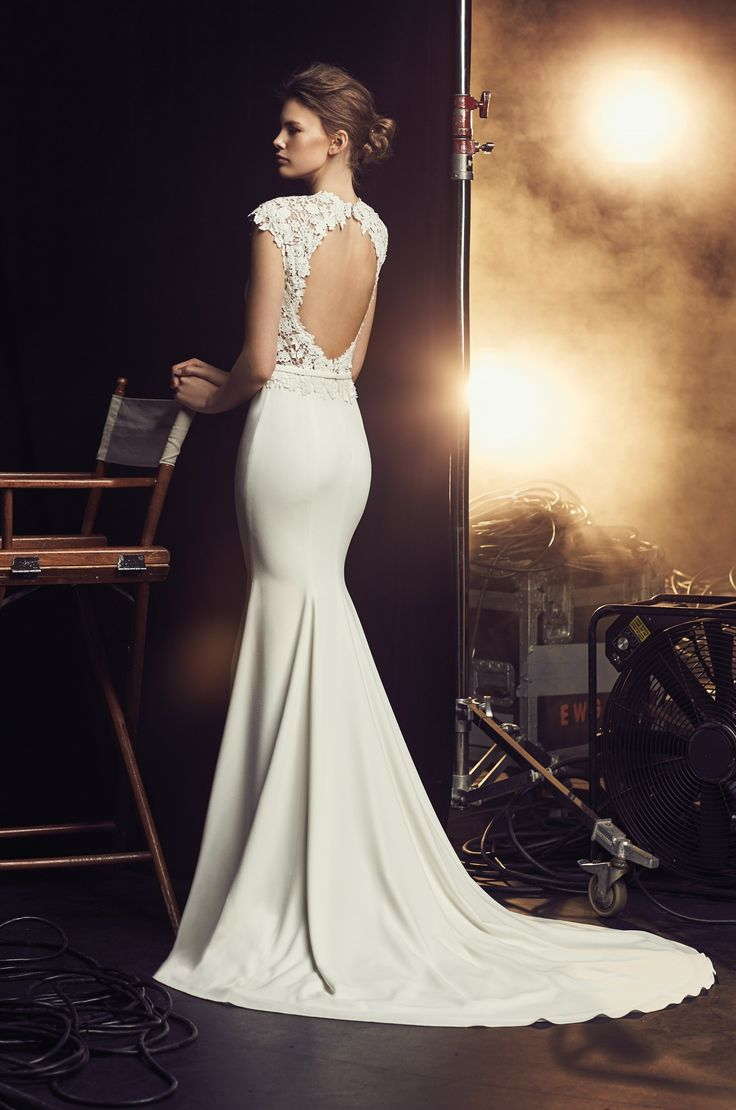 View our Open Back Wedding Dress - Style #2083 from Mikaella Bridal. Crêpe gown with cap sleeves, keyhole back and side inserts in guipure lace.