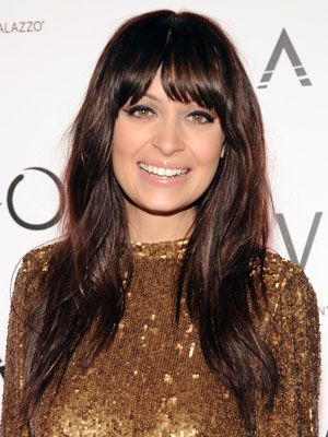 Not only do we love this chestnut brown, but Nicole's haircut and bangs are awesome!