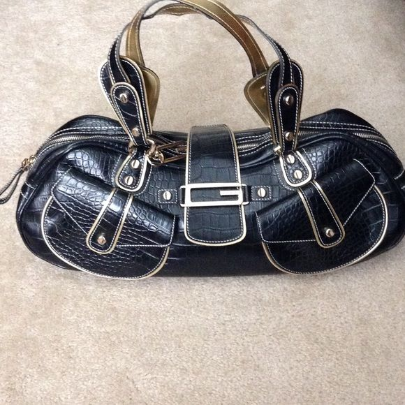 Guess Handbag Guess black and gold purse. NWOT Guess by Marciano Bags