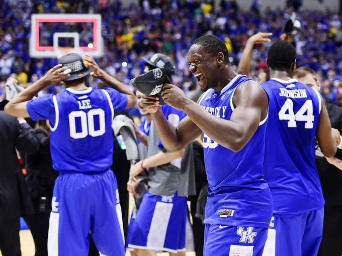 Kentucky Wildcats forward Julius Randle (30) celebrates with teammates after defeating the Michigan Wolverines.