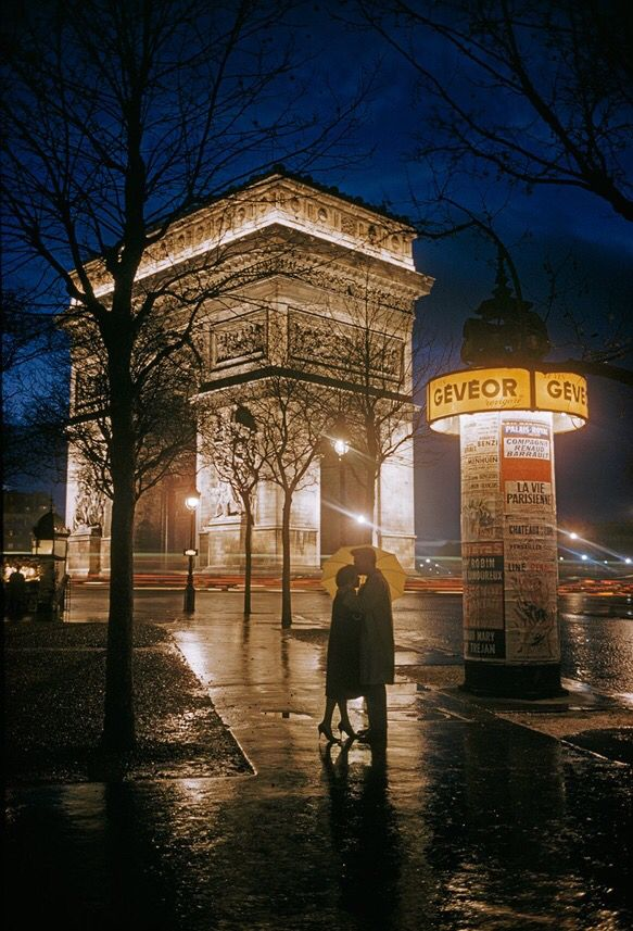 Young lovers embrace at Arc de Triomphe in Paris, 1960. Photograph by Thomas Nebbia, National Geographic Creative.