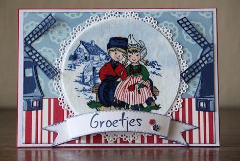 Nog Hollandser dan dit gaat het niet worden denk ik. Een boerenstel in klederdracht met molens in rood-wit-blauw! Het plaatje heb ik ui...
