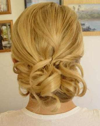 Low bun with curled, short, layers pinned on top.