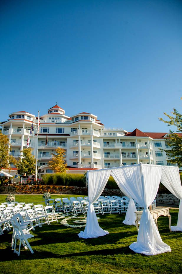 Elegant waterfront wedding ceremony on Lake Michigan at The Inn at Bay Harbor | Romantic wedding aisle with flower petals (NeriPhoto)