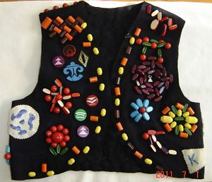 I had one of these jackets! Still do. My mom made it. We designed it and it looks different than the one shown. She used to sit down and help me earn beads. She was my leader!   .......Campfire Girls