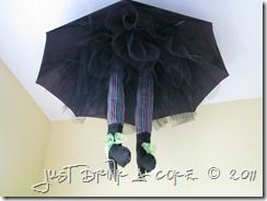 Wicked Witch through the ceiling...  CUTE.  Umbrella, tulle, striped stockings, felt shoes.