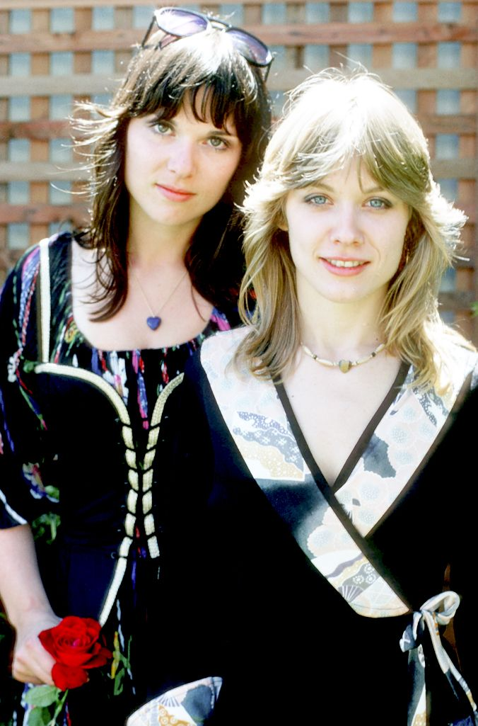 """Sisters and musicians Ann Wilson and Nancy Wilson of the rock band 'Heart' pose for a portrait session in September 1976 in Los Angeles, California. Photo by Michael Ochs  """