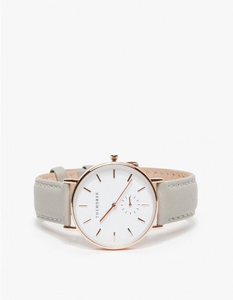From The Horse, a timeless, narrow-body wrist watch with a clean-lined dial and a sundial to count seconds. Features a supple Italian leather strap with beige nubuck lining.   •Classic wrist watch  •Stainless steel case, case back and bezel  •Ge