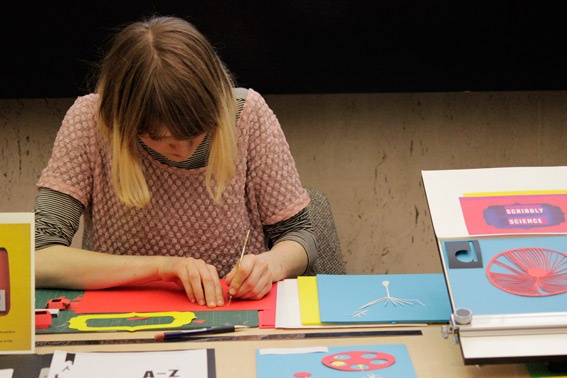 "Live illustrating (cutting out) at the British Library event ""Illustrated Books""."