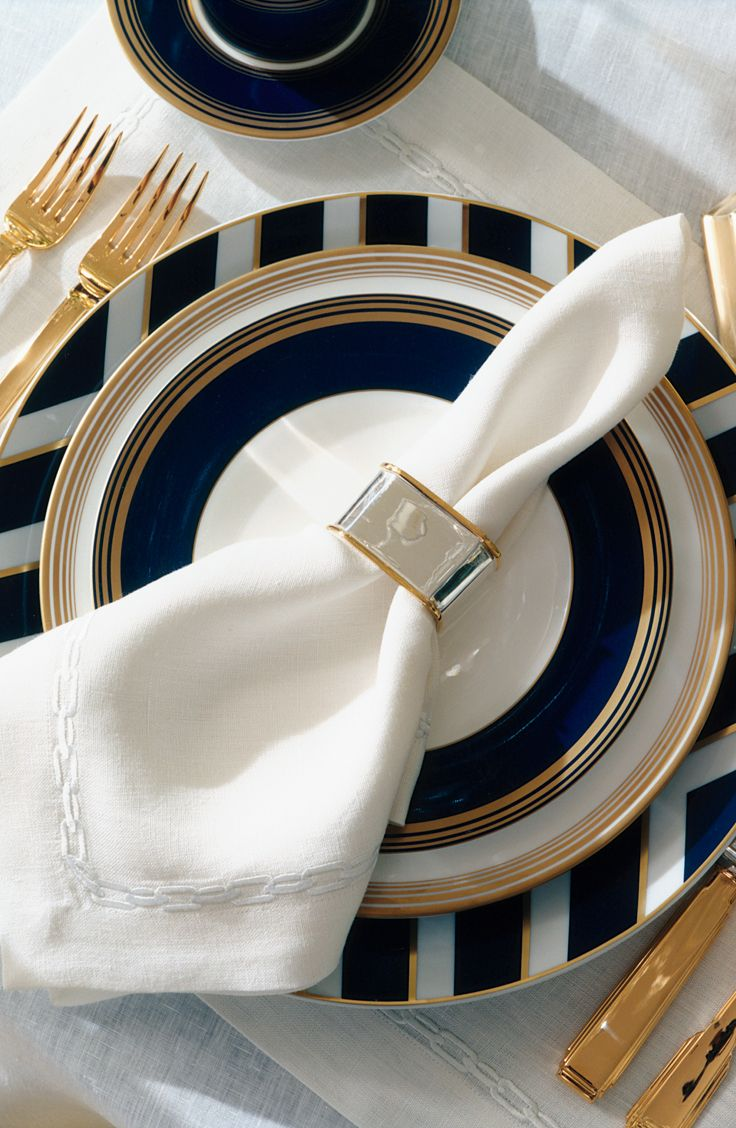 Riviera-inspired entertaining captured in a blue, white and gold table setting from Ralph Lauren Home: