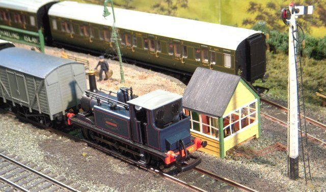 """With a rake of Maunsell carriages across the platform, blue liveried Stroudley designed Class A1 """"Bodiam"""" was just one of a host of Brighton built 0-6-0Ts dominating Hayling Island's steam motive power."""
