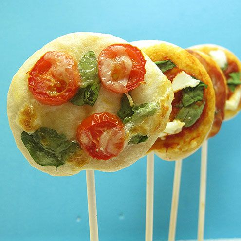 9 Cool Ways to Hack Your Pizza | PIZZA LOLLIPOPS | Cute, clever and easy to eat, there are lots of reasons why food is superior when it's served on a stick. And with her truly adorable pizza lollipops, which would be perfect for parties, blogger Meaghan Mountford of The Decorated Cookie proves that this fact applies to pizza, too.