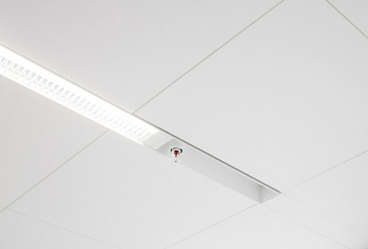 EXTEND INTEGRATED - RH ARKITEKTER /  A specially extruded aluminium U-profile integrates the light fitting, sprinklers, movement sensors, smoke detectors etc. keeping the ceiling surface clean and astringent, with easy access to the concealed installations above the ceiling.