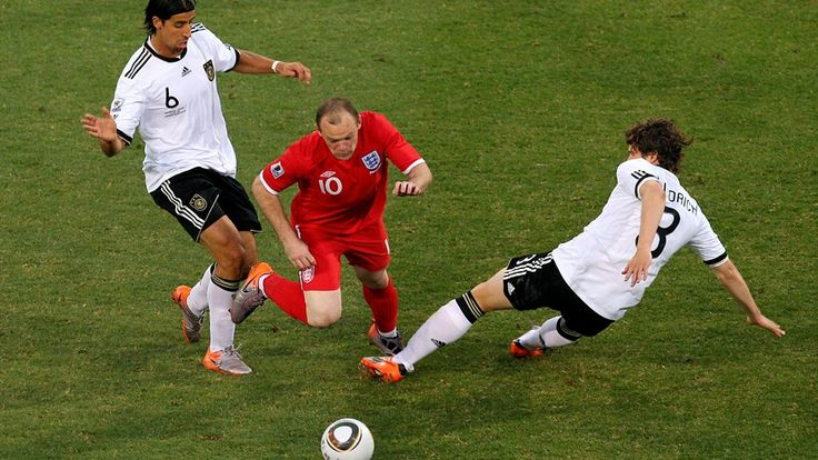 BLOEMFONTEIN, SOUTH AFRICA - JUNE 27: Wayne Rooney of England is tackled by Sami Khedira (L) and Arne Friedrich of Germany during the 2010 FIFA World Cup South Africa Round of Sixteen match between Germany and England at Free State Stadium on June 27, 2010 in Bloemfontein, South Africa. (Photo by Cameron Spencer/Getty Images)