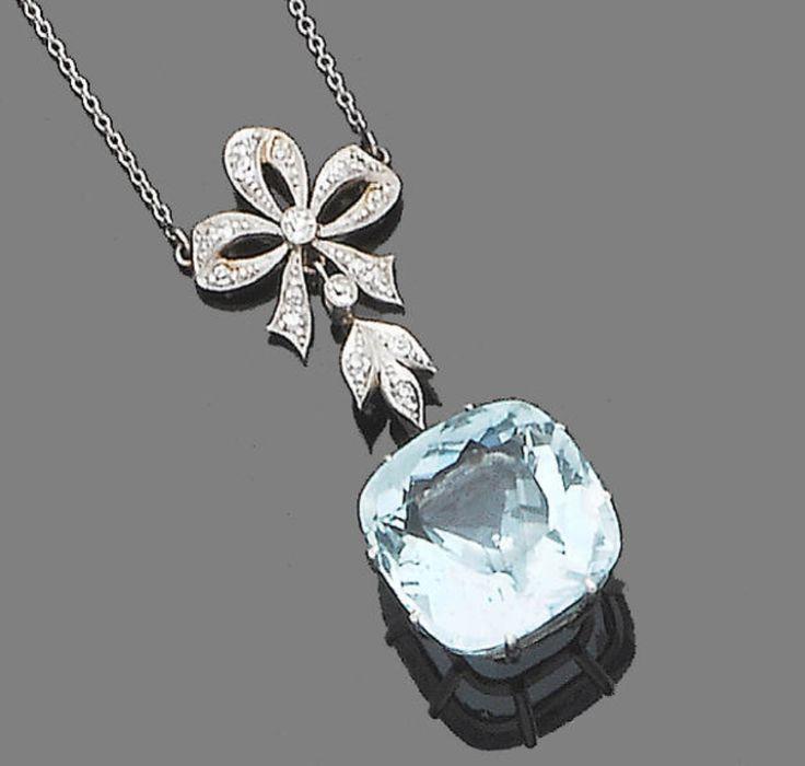 A belle époque aquamarine and diamond pendant necklace, circa 1910  The millegrain-set single-cut diamond ribbon bow surmount, terminating in a cushion-shaped aquamarine drop, suspended from a fine trace-link chain, lengths: pendant 4.9cm., chain 44.5cm., cased by Liberty, London-Paris