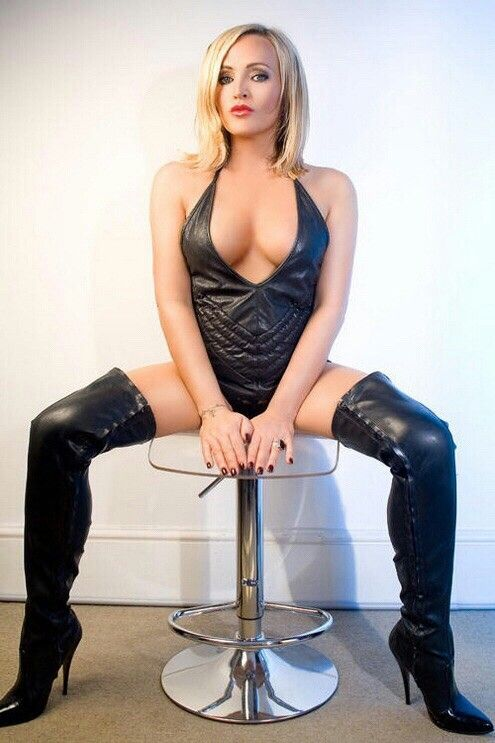 ee4530534d6 Blonde in black leather halter top and thigh boots