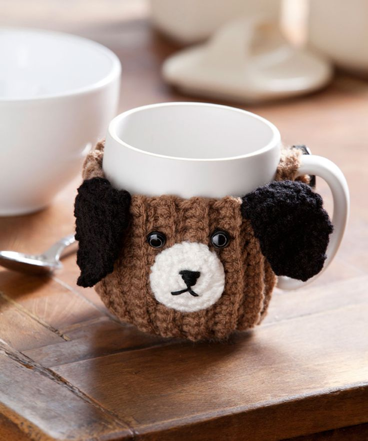 Here's a clever crocheted mug hug that is a fun gift for animal lovers of any age. It will encourage kids to drink their milk or keep drinks warm for older folks. Made with easy-care yarn, you can wash it often and it will stay looking great.