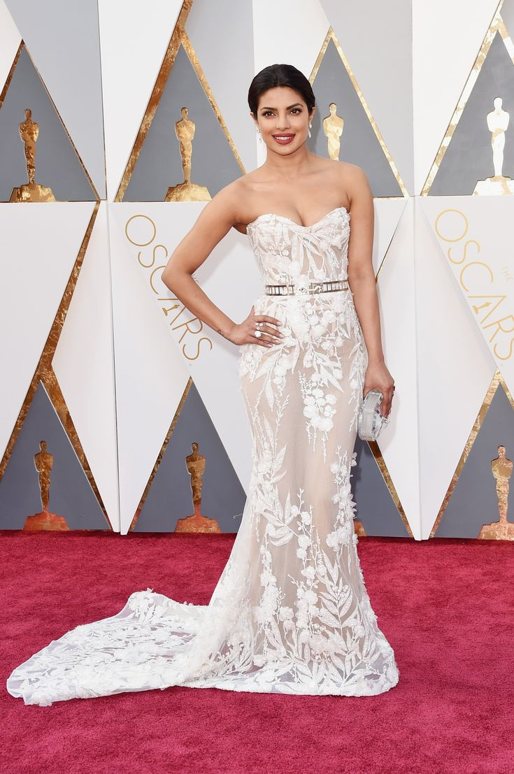 Priyanka Chopra in a Zuhair Murad dress and Lorraine Schwartz jewelry with Rauwolf clutch at the 2016 Oscars #AcademyAwards
