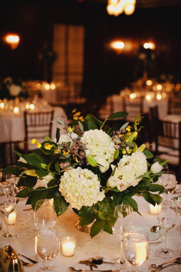 Cream Hydrangea and Magnolia Leaf Reception Arrangement   photography by http://www.kristynhogan.com/