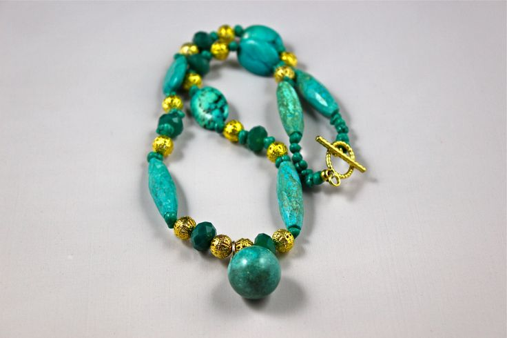 "Beautiful Turquoise 19"" Semi Precious Gem Stone Necklace. It has matching bracelet and earrings."