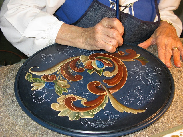 I love Norwegian Rosemaling. Look at the slightly gnarled hands doing the work. It makes my lonesome for my auntie Teresa.