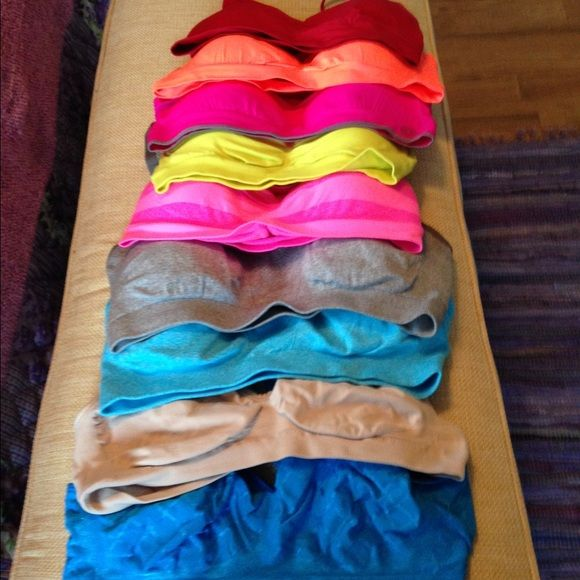 9 Sports bras size XL The 2 on the bottom ( beige & blue ) worn a few times.  The other 7 colorful sports bras new never worn. Bought at Marshalls and TJ Maxx. Intimates & Sleepwear Bras