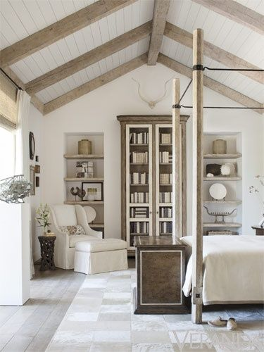 Neutral Bedroom Decor With Canopy Bed And Wood Beam Ceiling. Home Decor