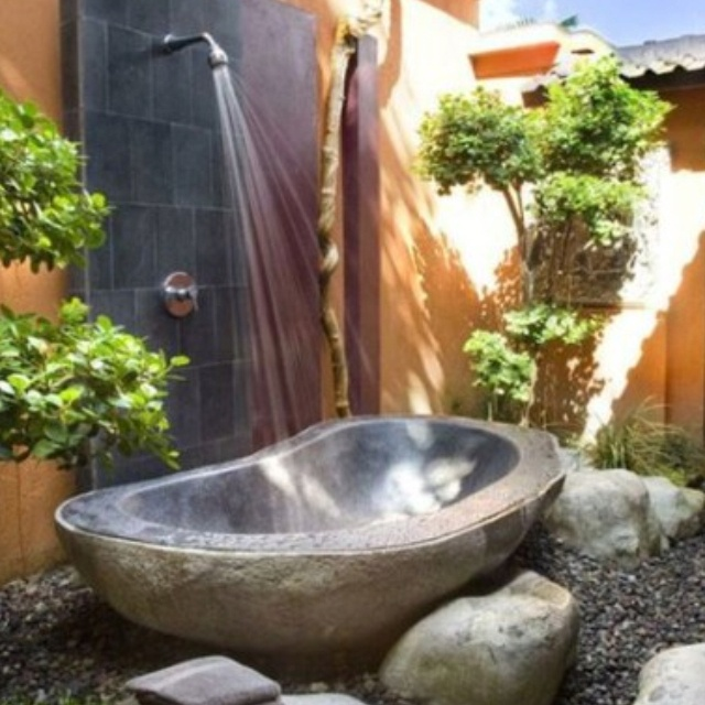 Stone carved bath tub. Back to nature.