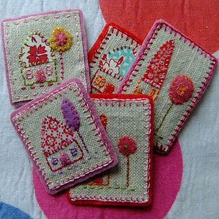 Sweet little house brooches  Embroidery.  I would adjust them and make them inchies.