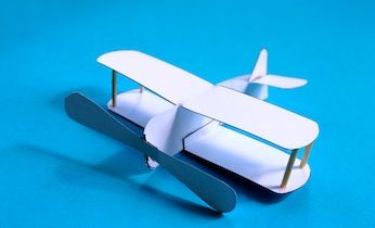 Looking for paper planes and and activities with free printables? Make this easy biplane using a free printable template for a simple model airplane.