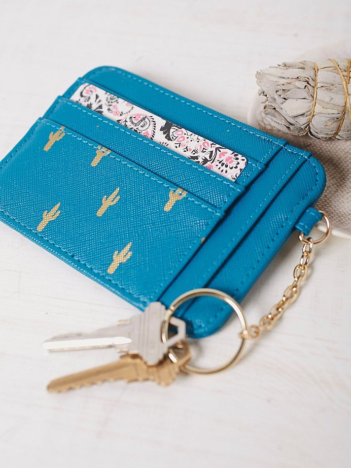 Onward Vegan Keyring   Super cute and extremely convenient wallet keychain featuring multiple credit card and cash slots.  Zipper closure coin pocket.  Textured vegan leather with an allover design.  Shipped in a perfect gift box.