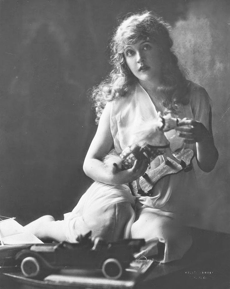 "Mae Murray (1885-1965). American actress, dancer, film producer, and screenwriter. Murray rose to fame during the silent film era and was known as ""The Girl with the Bee-Stung Lips""."