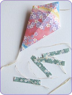 Easy Origami Kites Step 4  Thinking May 12th is Craft Day. Something easy?
