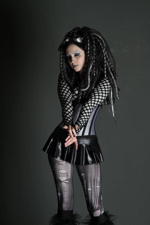 cyberpunk, Cyber Goth, dystopian fashion, girl in black, alternative girl, black skirt, sythetic dreads, cyber goggles, goth clothing, black by FuturisticNews.com