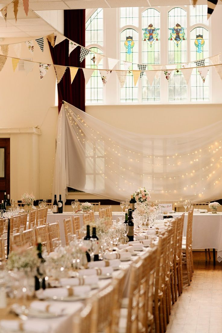 Fairy Light Backdrop Drapes Bunting Long Tables Pretty DIY Pink Village Hall Countryside Wedding http://www.jobradbury.co.uk/