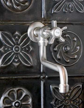 tin tile backsplash, new reproduction pot-filler faucet  -Andrea/Rose Tree Originals~Quilts & More Victorian Kitchen at Christmas - Country Living