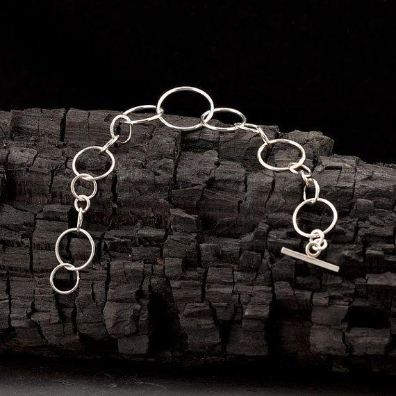 Sterling silver loop bracelet. Loops of differing size. On Etsy.