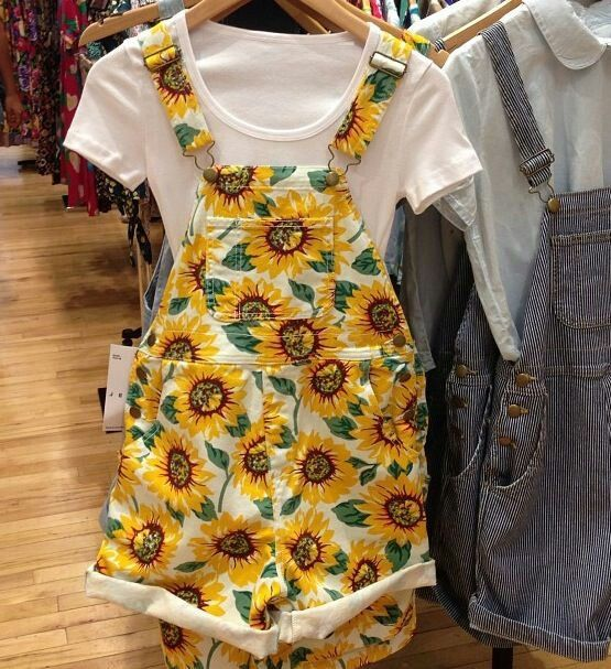 Sunflower Bib Overall Shorts With A White Babydoll T-Shirt Underneath