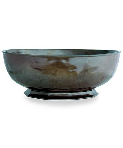 Pewter Stoneware Large Serving Bowl - Low, wide, and high-sided, the Pewter Stoneware Large Serving Bowl is an elegant, transitional take on classic pewter ware, but rendered in ceramic with a smooth, rich metallic glaze to bring the look alive with depth while easing the care for this upscale showpiece. Pile with seasonal fruit, artisan breads, or tossed greens for a serving piece that doubles as a heartfelt decorative element.