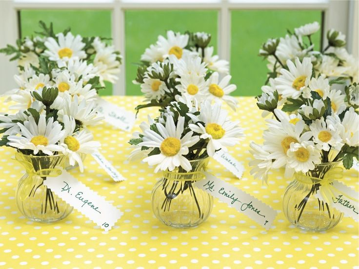 Such a cute idea and cheap as well. Fill little jars with small bunches of daisies with a tag for place settings! Perfect for Summer.