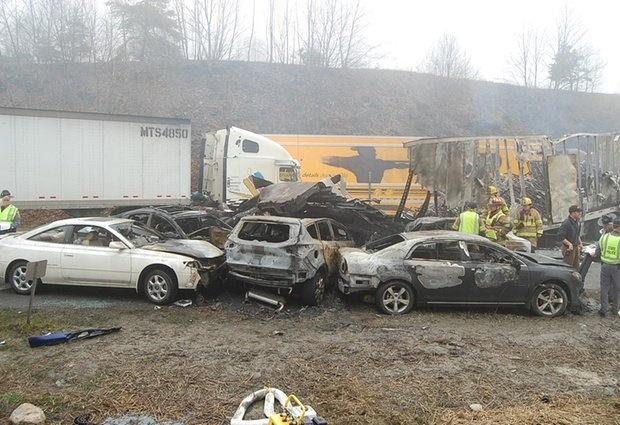 The scene following a 75-vehicle pileup on Interstate 77 near the Virginia-North Carolina border in Galax, Va., on Sunday, March 31, 2013. Virginia State Police say three people have been killed and more than 20 are injured and traffic is backed up about 8 miles.