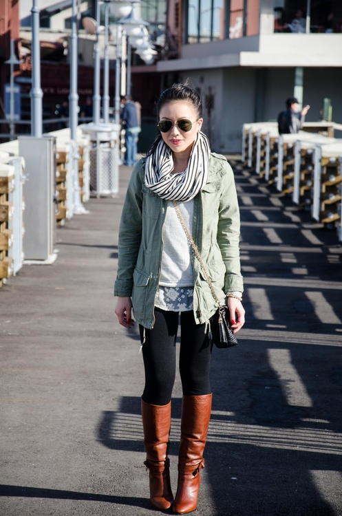 army green / olive jacket, striped scarf, leggings & tall brown boots