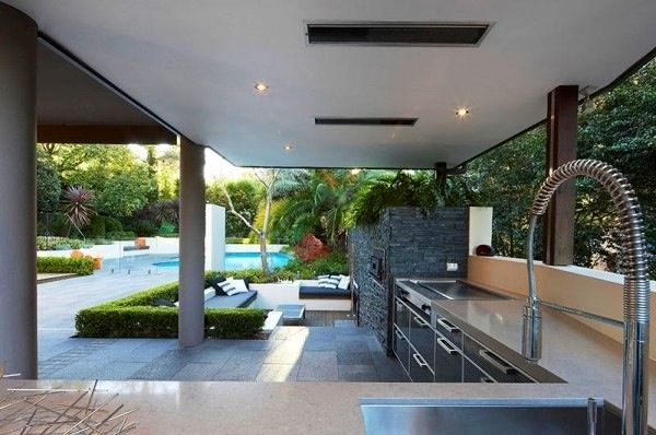 This low maintenance full sized outdoor kitchen synergies beautifully with outdoor lounge and pool area.