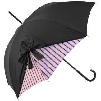 Supremely elegant umbrella, appears to have top canopy lifted and tied into a sumptuous bow, revealing its contrasting underskirt. When folded the bow gives the umbrella a unique French style. Manual metal frame, black crook handle.