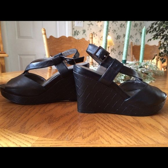 Ana Black Peep Toe wedge Platform 7.5 New without box! I believe this is a faux leather mayerial. Ana brand black peep toe wedges with a woven look over the platform. Purchased new for $65. Women's size 7.5. a.n.a Shoes Wedges